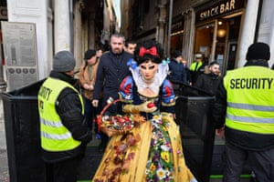 Venice, Italy. Security officers check attendees in fancy dress in Piazza San Marco during the Venice carnival