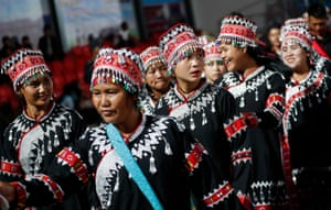 Wa ethnic women in traditional dress attend a rehearsal of a military parade to celebrate 30 years of the founding of the independent Wa state and the ceasefire signed with the Myanmar military.