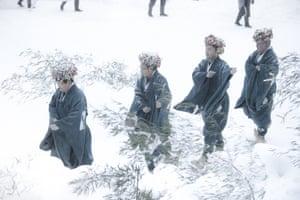 A procession crosses the snowy landscape