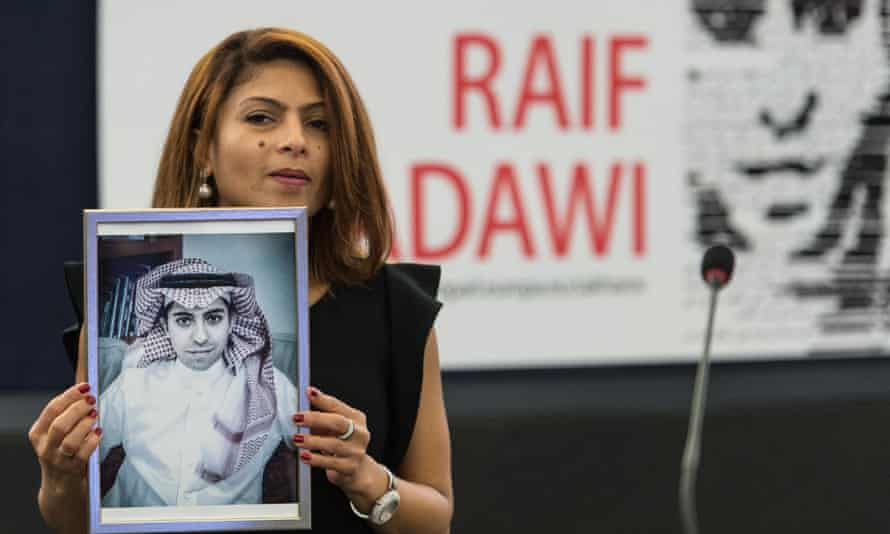 Ensaf Haidar, wife of jailed Saudi blogger Raif Badawi, holds a picture of her husband in the European Parliament in Strasbourg.