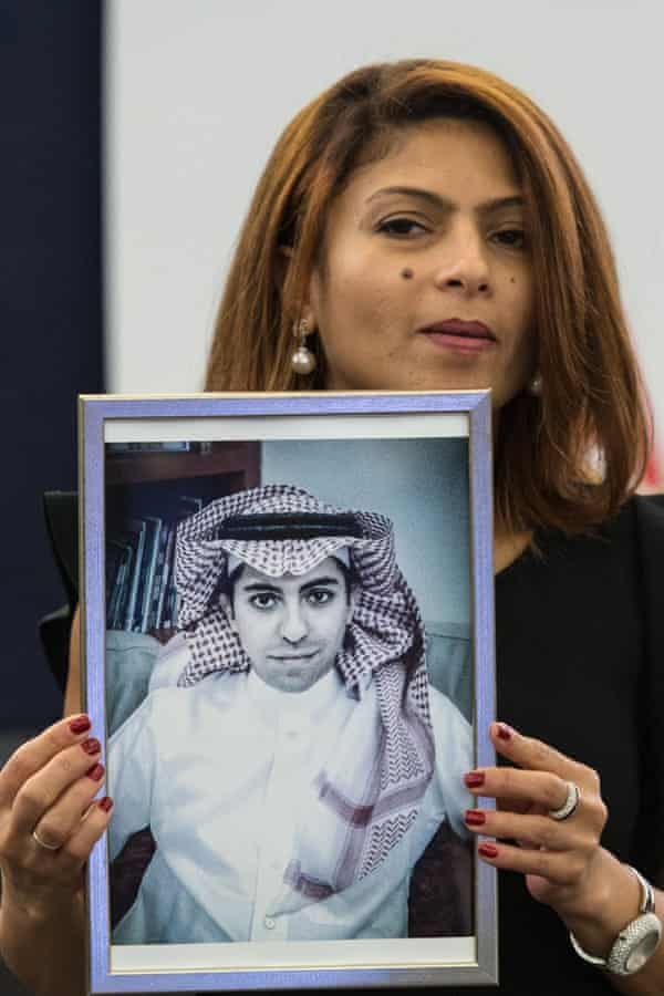 Ensaf Haidar, wife of jailed Saudi blogger Raif Badawi, holds a picture of her husband in the European parliament in Strasbourg, France.