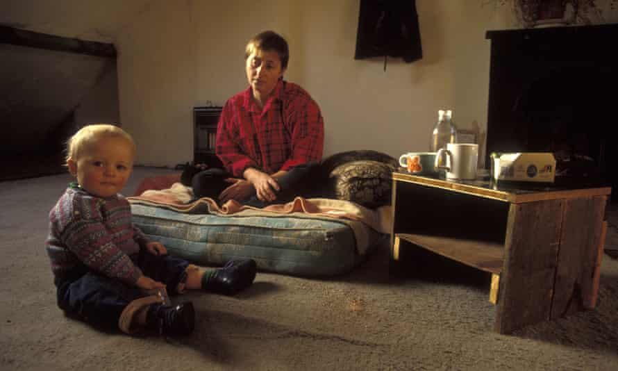 A mother & child in poor housing