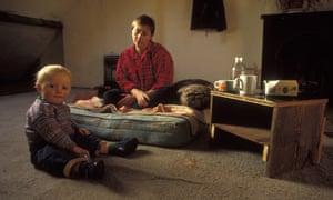 Mother and toddler in stark, slum-type room
