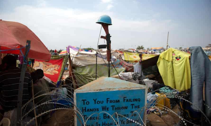 A monument for peacekeepers who have died amid tents in a camp for internally displaced people at the Unmiss base in Juba, 2014.