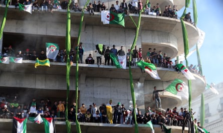Protesters gather on a building in Algiers