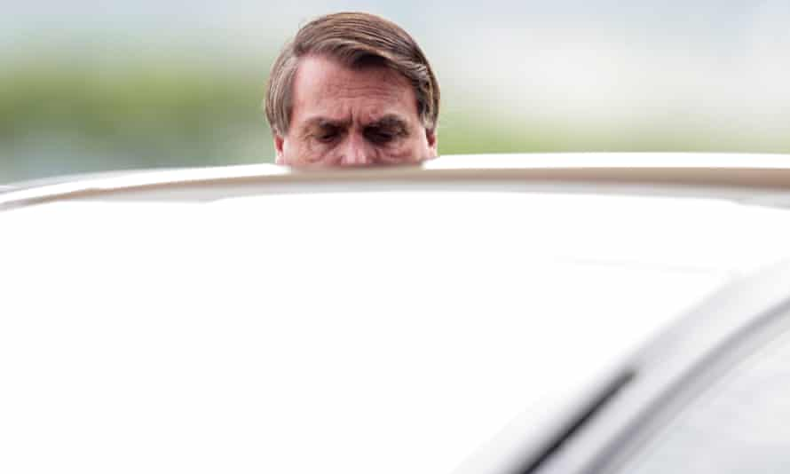 President Jair Bolsonaro speaks with supporters while he leaves Alvorada Palace in Brasilia on Tuesday.