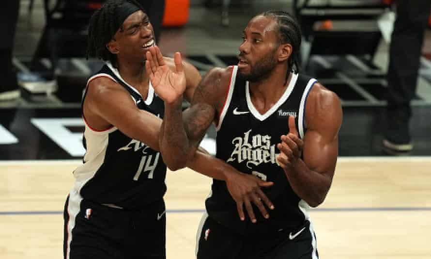 Terance Mann and Kawhi Leonard celebrate as their team head towards victory in the NBA playoffs