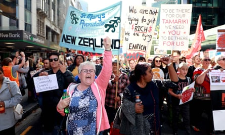 Thousands of teachers, parents and schoolchildren march up Queen Street as they protest in Auckland, New Zealand.