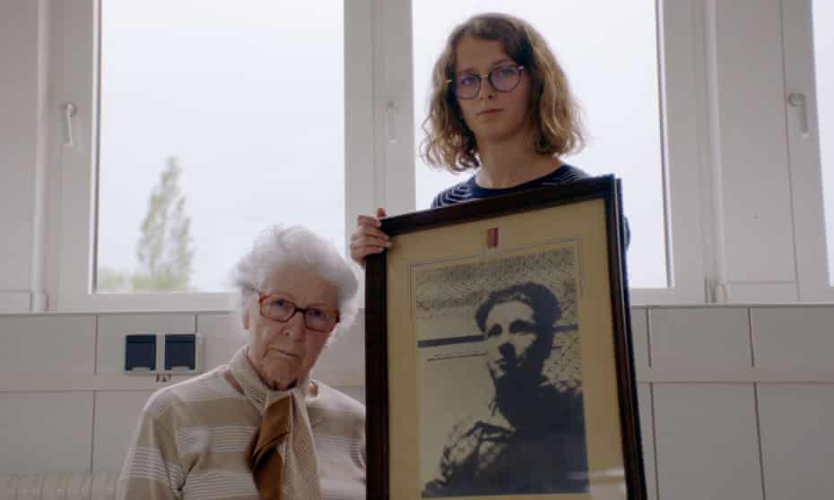 Colette Marin-Catherine, left, with Lucie Fouble, who holds a photograph of Colette's brother, Jean-Pierre