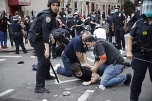 A New York City police officers arrest a protester in Brooklyn on 30 May