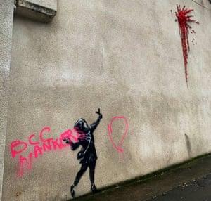A vandalised new Banksy artwork is seen in Barton Hill, Bristol