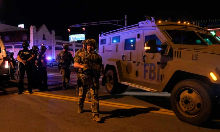 FBI agents patrol near the site where two police officers were shot in downtown Louisville, Kentucky, on September 23, 2020.