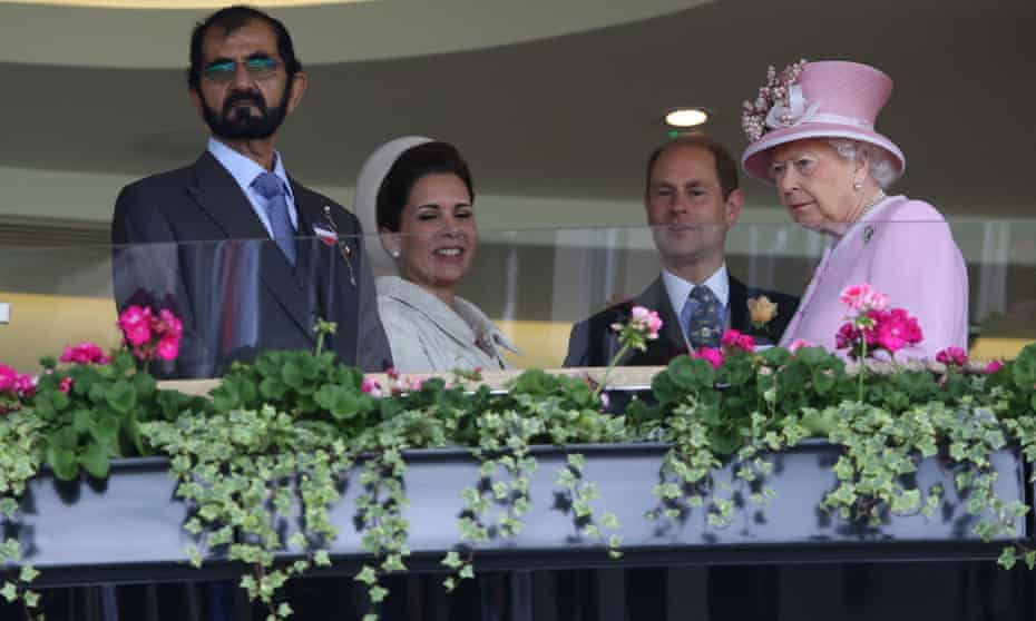 The Queen with Sheikh Mohammed, left, in the Royal Box at Ascot in 2016.