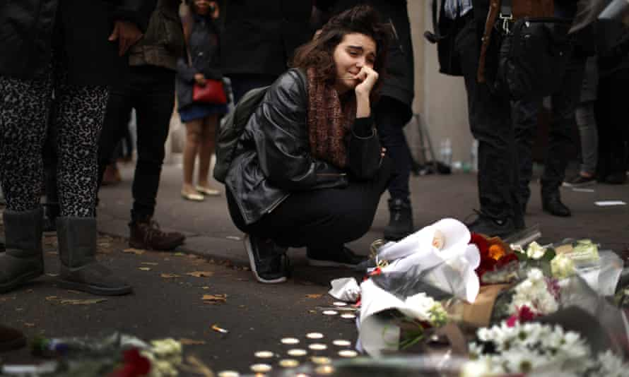 A woman places flowers near the scene of the Bataclan theatre attack.