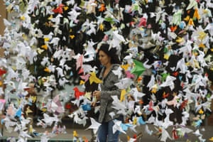 A woman walks past paper birds placed by WWF activists opposite the Spanish Lower House in Madrid, Spain on 24 November, to demand greater protection of Doñana national park in Andalucia