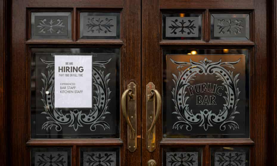 A help wanted sign on a pub door in London.