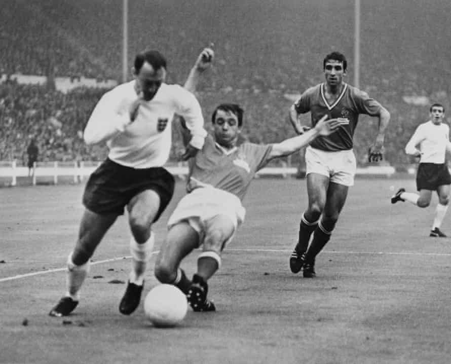 Jimmy Greaves slips away from France's Jacky Simon during England's group-stage win at the 1966 World Cup
