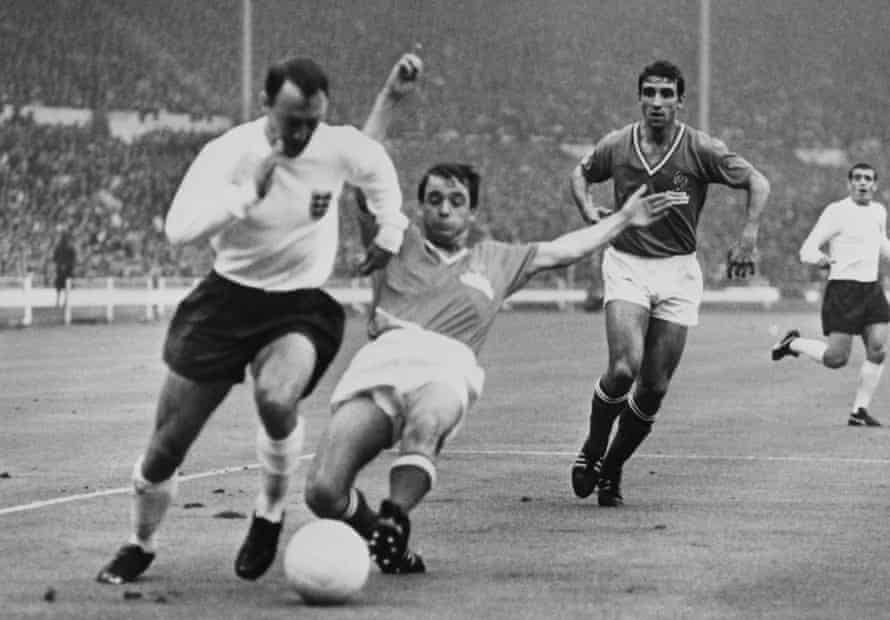 Jimmy Greaves, left, playing for England against France at Wembley Stadium in the 1966 World Cup.