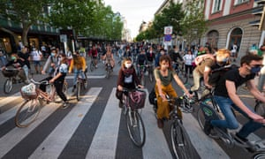 Slovenian citizens wearing protective masks ride their bikes as they block the centre of capital Ljubljana to protest against the centre-right government, accusing it of corruption and of using the pandemic to restrict freedom on 8 May, 2020.