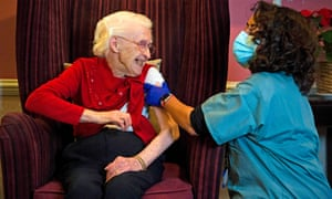 Ellen Prosser, 100, receives the Oxford/AstraZeneca vaccine from Dr Nikki Kanani at the Sunrise Care Home in Sidcup, London. The race is on to inoculate those most at risk.