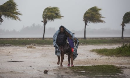 A woman and child fleeing from Caibarién, on the northern coast of Cuba