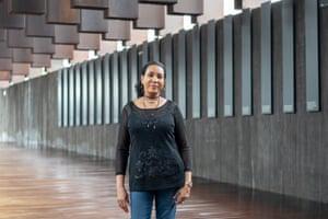 Vanessa Croft stands in front of the EJI memorial.