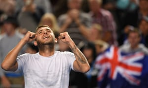 Dan Evans celebrates his victory against Bernard Tomic.