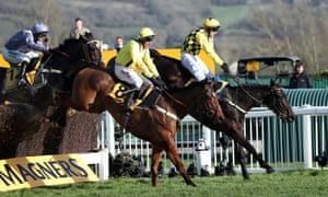 Al Boum Photo ridden by Paul Townend (right) jumps the last on the way to winning the Gold Cup.