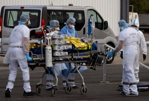 Avignon, France. Hospital staff load patients with Covid-19 on to a plane to be evacuated