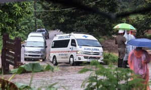 An ambulance leaves from the Tham Luang cave area as the operations continue for those still trapped inside the cave in Khun Nam Nang Non Forest Park