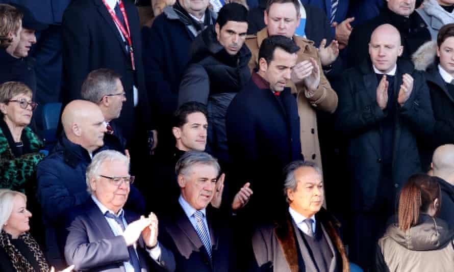 Mikel Arteta goes to take his seat as Carlo Ancelotti stands between Everton's chairman, Bill Kenwright, and majority owner, Farhad Moshiri