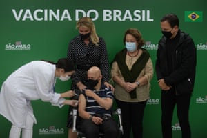A man with Down's syndrome receives the vaccine in Sao Paulo.