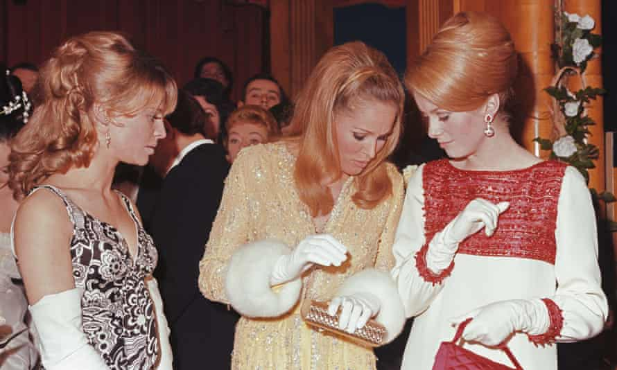 From left, Julie Christie, Ursula Andress and Catherine Deneuve attend a royal film performance at the Odeon, Leicester Square, in 1966.