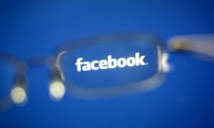 Facebook logo seen through glasses
