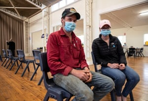 Farmers Jack Forum and Paige Tilse wait in the Dunedoo Jubilee Hall after receiving Pfizer vaccinations