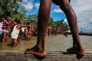 People gather to receive aid at Guthail, Jamalpur, Bangladesh.