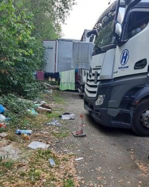 A Hegelmann lorry parked alongside makeshift living arrangements
