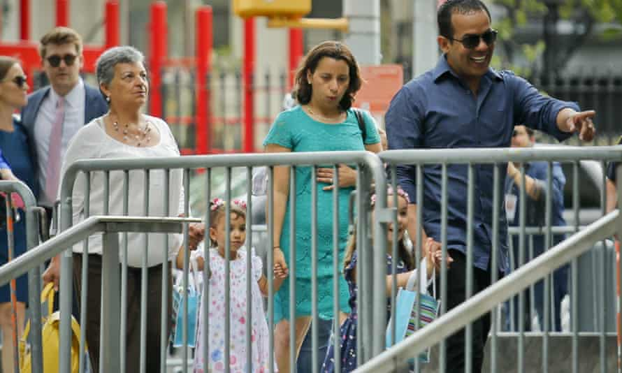 Pablo Villavicencio with his wife Sandra Chica, center, and their children, arrive for his court hearing at federal court on Tuesday in New York.