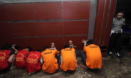 Jakmania supporters are held following trouble in the game against Sriwijaya last June, when a policeman was left in a coma.