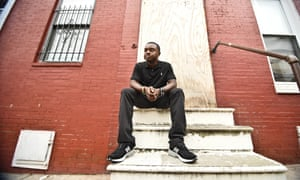 Davon Mayer on the steps of his old home in west Baltimore