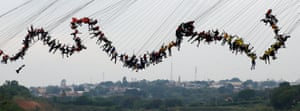 "A group of 245 people all attached to safety cords jump off a 30-metre bridge together in an attempt to set a new world record for ""rope jumping"""