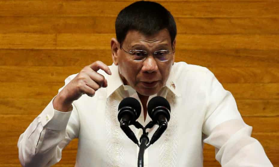 Rodrigo Duterte gestures as he delivers his sixth state of the nation address in Quezon City, Metro Manila