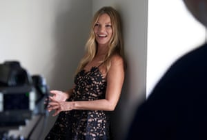 Kate Moss laughs between scenes whilst filming for the Self-Portrait AW2021 campaign