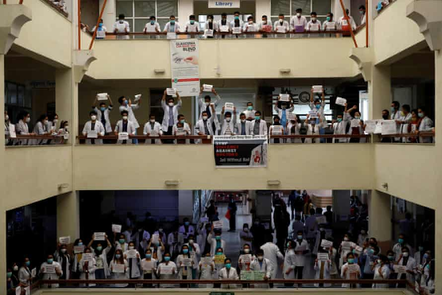 Doctors holding placards protest attacks on doctors at Nepal Medical College and Teaching Hospital during a lockdown in Kathmandu on May 31.