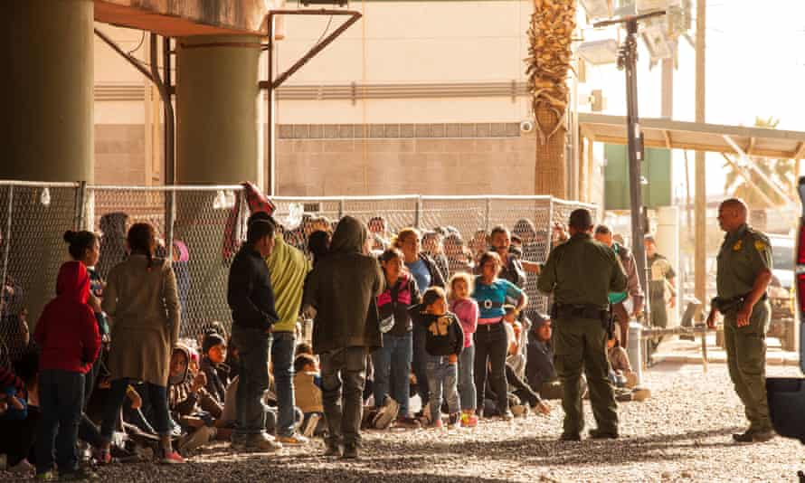 Migrants await processing.