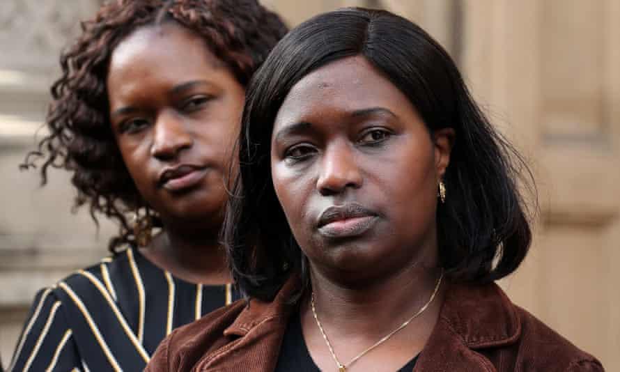 Kadijatu Johnson (right) and Adama Jalloh, sisters of Sheku Bayoh, speak to the media outside the Crown Office in Edinburgh.