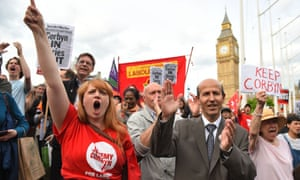 "The Momentum campaign group holds a ""Keep Corbyn"" demonstration outside parliament in London."