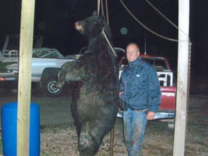 Palmer in another photo with the black bear.