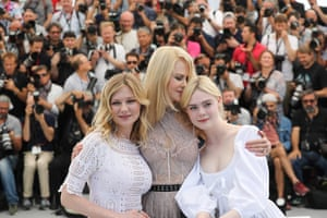 Kirsten Dunst, Nicole Kidman and Elle Fanning pose during a photocall for the film 'The Beguiled'