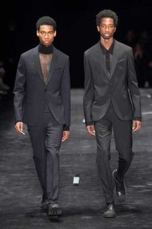 NEIL BARRETTNeil Barrett explored the notion of uniforms from school to office suits and the military. With an emphasis on tailoring, there were military coats in army green and aviator jackets in shades of navy, black, khaki, sand and airforce blue. Unusually for Barrett there was no pop of colour – three inky blue leather pieces were as bright as it got.
